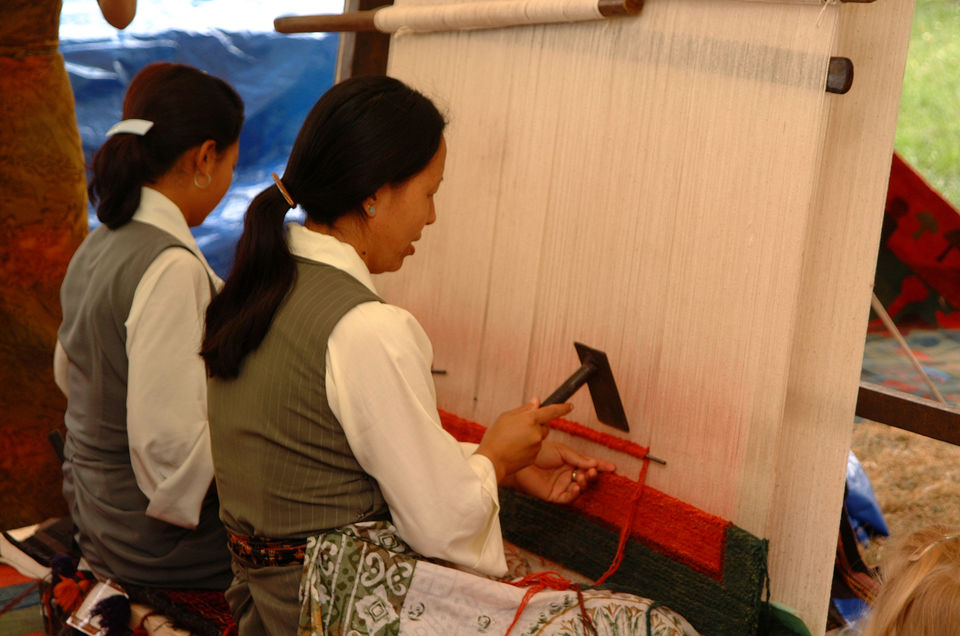 "Photos of <a href=""https://upload.wikimedia.org/wikipedia/commons/e/ef/Description-_Tibetan_carpet_weavers_from_Nepal_demonstrate_their_skills_during_the_2002_Smithsonian_Folklife_Festival_featuring_The_Silk_Road._%282548100217%29.jpg"">credit</a> 1/1 by Lost Passenger"